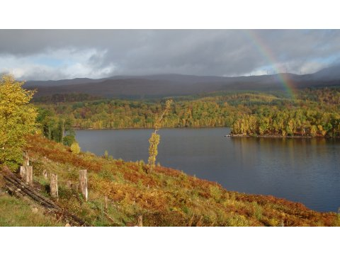 A rainbow over beautiful Loch Garry.