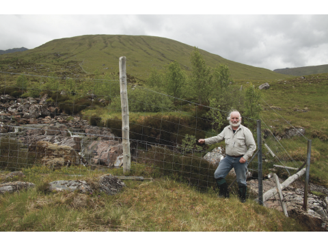 Alan at the same spot in June 2012, showing the natural regeneration that has taken place inside the fence.